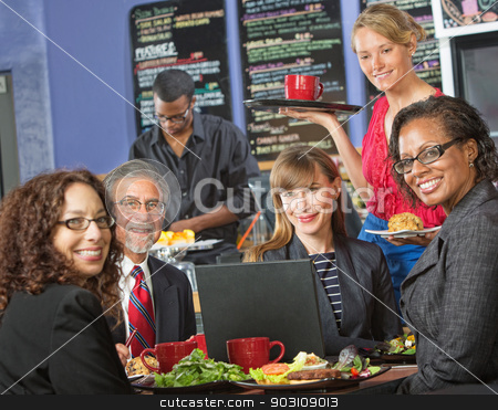 Happy Group with Laptop in Cafe stock photo, Happy group of people with laptop in cafe and barista by Scott Griessel