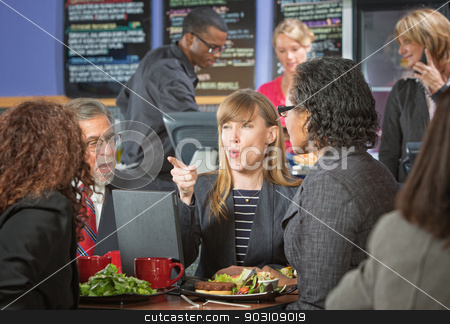 Business People Arguing in Cafe stock photo, Group of business people arguing in cafeteria by Scott Griessel