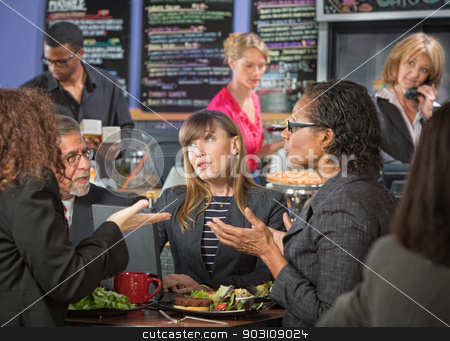 Mature Workers Talking in Cafe stock photo, Mature diverse group of adults talking in indoor cafe by Scott Griessel