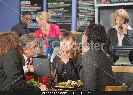 Surprised Executives in Cafeteria stock photo, Surprised beautiful white collar worker with diverse group in cafe by Scott Griessel