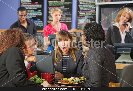 Shocked Woman in Cafe stock photo, Shocked Hispanic woman in coffee house with coworkers by Scott Griessel