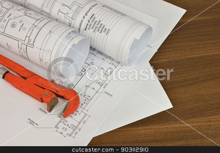 Adjustable wrench and drawings on the desktop stock photo, Adjustable wrench and drawings on the desktop. Concept of repair and construction by cherezoff