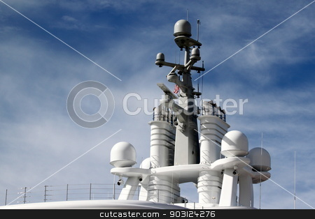Radar stock photo, Radar system on to of a ship with blue cloudy sky in the background. by Henrik Lehnerer