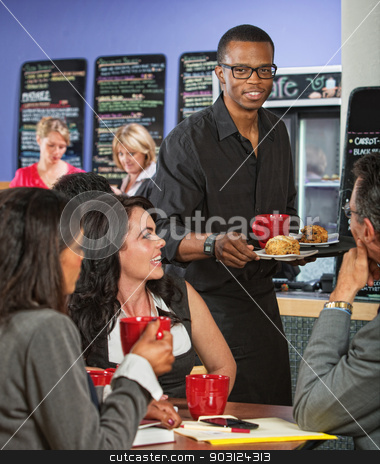 Waiter Bringing Food to Customers stock photo, Cheerful waiter bringing customers scones and coffee by Scott Griessel