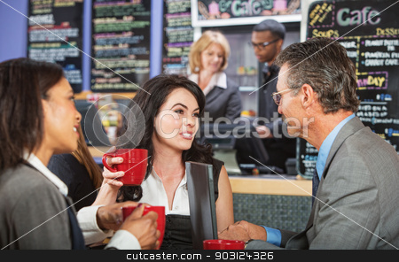 Mixed Group Talking in Cafe stock photo, Mixed group of coworkers talking in a cafe by Scott Griessel