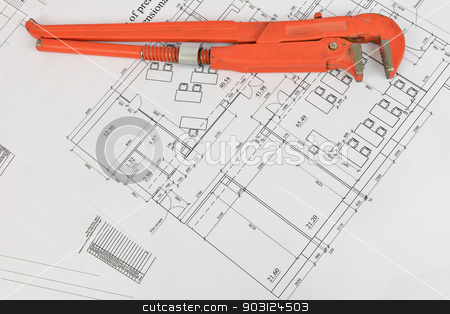 Adjustable wrench and drawing on the desktop stock photo, Adjustable wrench and drawing on the desktop. Concept of repair and construction by cherezoff
