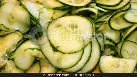 Cucumber Slices stock photo, Pile of fresh cucumber slices ready for a salad. by Henrik Lehnerer
