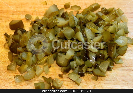 Diced Pickles stock photo, Pile of dice pickles ready for use in cooking. by Henrik Lehnerer
