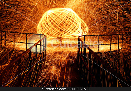 Hot glowing stock photo, Showers of hot glowing sparks from spinning steel wool by Nneirda