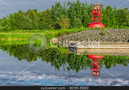 A buoy on land  stock photo, An abandoned red buoy on dry land by a lake and a dock in Ontario, Canada. by Peter Kolomatski