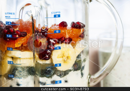 Blender with fruit and yogurt for smoothies stock photo, Closeup of healthy smoothie ingredients in blender with fresh fruit by Elena Elisseeva