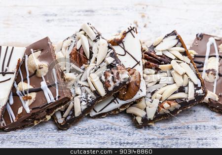 Chocolate caramel bark pieces stock photo, Assorted chocolate caramel bark pieces for sweet dessert by Elena Elisseeva