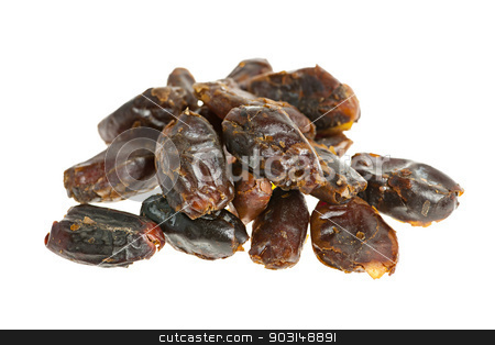 Dates on white background stock photo, Closeup on pile of dried medjool dates isolated over white background by Elena Elisseeva