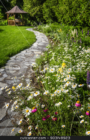 Wildflower garden and path to gazebo stock photo, Wildflower garden with paved path leading to gazebo and blooming daisies by Elena Elisseeva