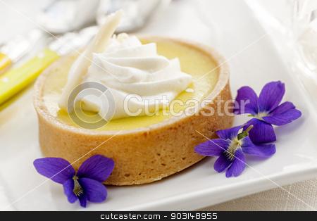 Lemon tart dessert stock photo, Fresh gourmet lemon dessert tart with edible violet flowers garnish by Elena Elisseeva