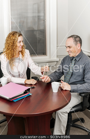 Agent giving keys to buyer stock photo, Female real estate agent handing keys to new home owner by Elena Elisseeva