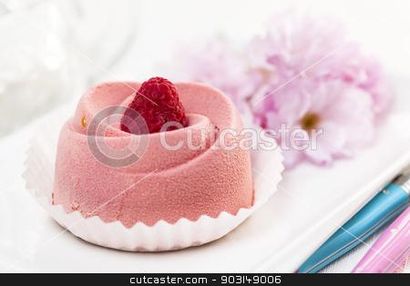 Raspberry mousse dessert stock photo, Closeup of pink raspberry mousse dessert with cherry blossom by Elena Elisseeva