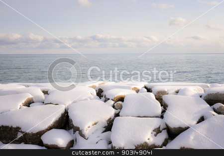 Winter shore of lake Ontario stock photo, Rocks under snow on winter shore of lake Ontario in Sylvan park Toronto by Elena Elisseeva