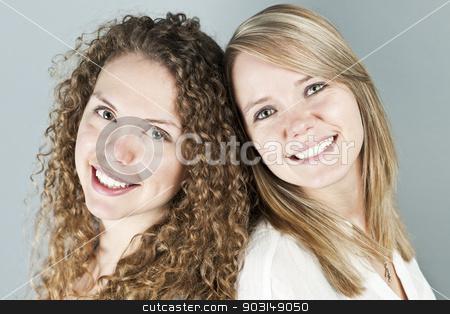 Portrait of two smiling women stock photo, Portrait of two pretty caucasian young women by Elena Elisseeva