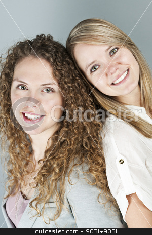 Portrait of two smiling women stock photo, Portrait of two pretty caucasian young women by Elena Elisseeva