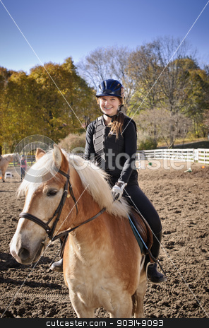 Young girl riding horse stock photo, Portrait of teenage girl riding horse outdoors on sunny autumn day by Elena Elisseeva