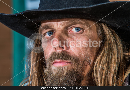 Bandit Close-up stock photo, Close-up of a gruff looking old west bandit by Scott Griessel