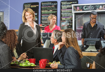 Happy Bistro Owner with Customers stock photo, Smiling cafe owner with group of business people by Scott Griessel
