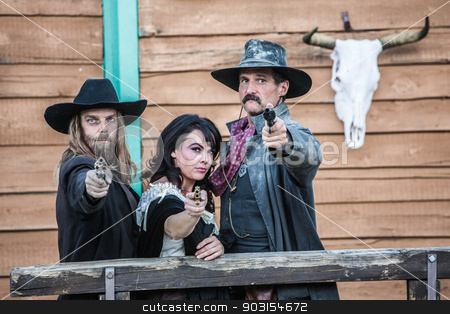 Old West Trio stock photo, Old west trio points guns at you by Scott Griessel