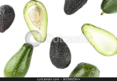 Black Ripe Avocados stock photo, Black Ripe Avocados with leaves. by Designsstock