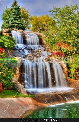 Silky Waterfall in High Dynamic Range stock photo, Steams of misty water fall down the hill in High Dynamic Range by Joseph Fuller