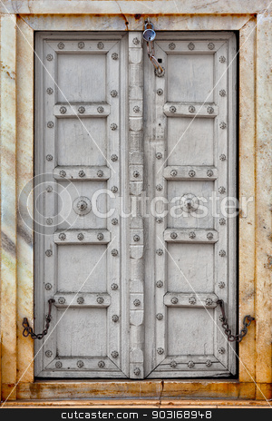 Agra, India. The old gray wooden door stock photo, Agra, India. The old gray wooden door on a facade by Alexey Romanov