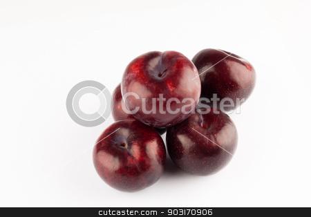 prune stock photo, big ripe prunes closeup on white backgroud by Felix Furo