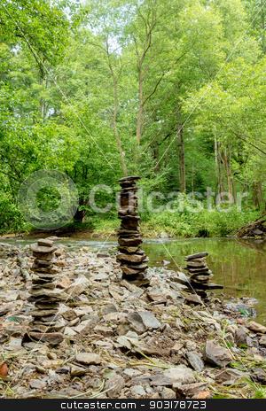 Stones pyramid near small river stock photo, three Stones pyramid near small river symbolizing zen, harmony, balance by Artush
