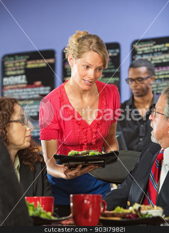 Apologetic Server stock photo, Apologetic server bringing salad to upset business man by Scott Griessel
