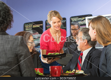 Barista Serving Business People stock photo, Young barista serving smiling executives food in cafe by Scott Griessel