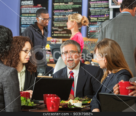 Executives Eating Lunch stock photo, Group of diverse executives eating lunch in cafeteria by Scott Griessel