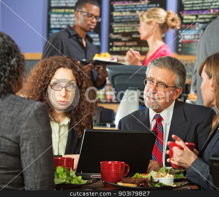 Serious Meeting in Cafe stock photo, Serious adult business people meeting at indoor cafe by Scott Griessel