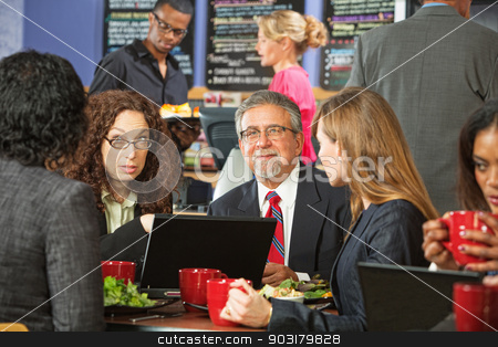 Group of Business People in Cafe stock photo, Adult business people meeting in a coffee house by Scott Griessel