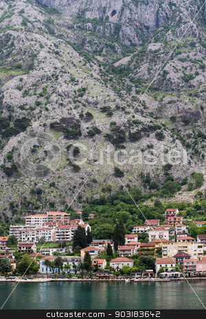 Buildings Between Mountian and Kotor Bay stock photo, Building with Red Tile roofs on coast of Montenegro by Darryl Brooks