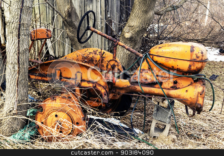 Yellow Tractor stock photo, Vintage and abandoned yellow rusting tractor. It is missing wheels and paint. by Leah Fallesen