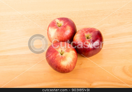 Three Apples From Above stock photo, Three apples on a wood table shot from above by Darryl Brooks
