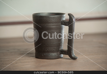 Traditional handcrafted mug stock photo, Traditional handcrafted mug - perfect for tea, coffee or beer by Alexey Kozak