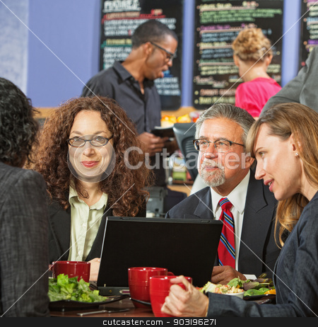 Executives Meeting Over Lunch stock photo, Group of executives meeting over lunch with laptop by Scott Griessel
