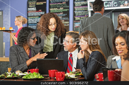Serious People Talking in Cafe stock photo, Business people in serious discussion during lunch in cafe by Scott Griessel