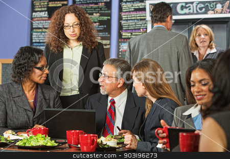 Four Business People at Lunch stock photo, Four business people meeting with laptop on lunch table by Scott Griessel