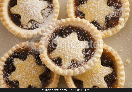 Background texture of Christmas mince pies stock photo, Background texture of decorative Christmas mince pies with crisp golden crusts and pastry stars for a traditional seasonal treat by Stephen Gibson