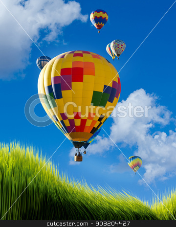 Hot Air Balloons. stock photo, Hot air balloons flying high over green grass. by WScott