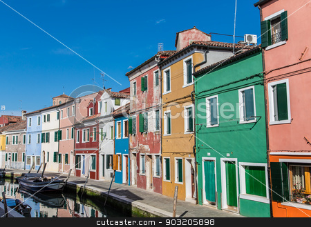 Street of Colors in Burano stock photo, A row of brightly colored homes in Burano, Italy by Darryl Brooks
