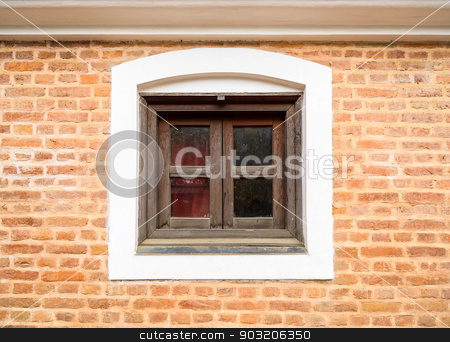 Small wooden window and brick wall stock photo, Small wooden window and brick wall by Dutourdumonde