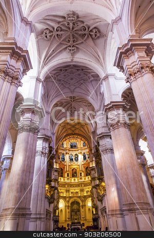 Basilica Stone Columns Stained Glass Baptismal Fount Cathedral A stock photo, Basilica Stone Columns Stained Glass Cathedral Andalusia Granada Spain.  Built in the 1500s, housing the tombs of King Ferdinand and Isabella.  Dome by Diego de Siloe, 16th Century Stained Glass by Juan del Campo. by William Perry